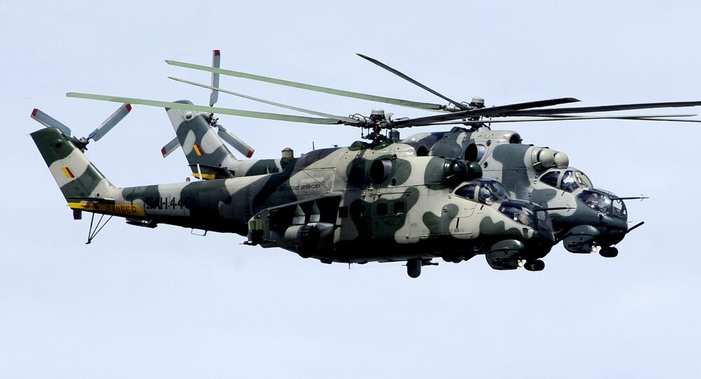 Sri Lankan Air Force pilots fly Mi-24 helicopter gunships during a passing out ceremony of 329 men and officers in the north-eastern town of Trincomalee on August 21, 2009