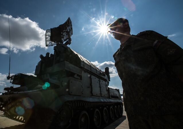 A serviceman is seen near a Tor surface-to-air missile system during preparations for the Engineering Technologies 2014 international forum in Zhukovsky near Moscow