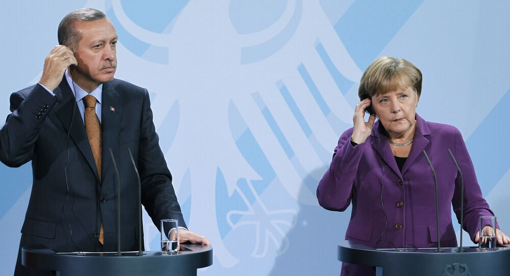 German Chancellor Angela Merkel, right, and Turkey's Prime Minister Recep Tayyip Erdogan, left, address the media during a news conference after a meeting at the Chancellery in Berlin, Germany, Wednesday, Nov. 2, 2011.
