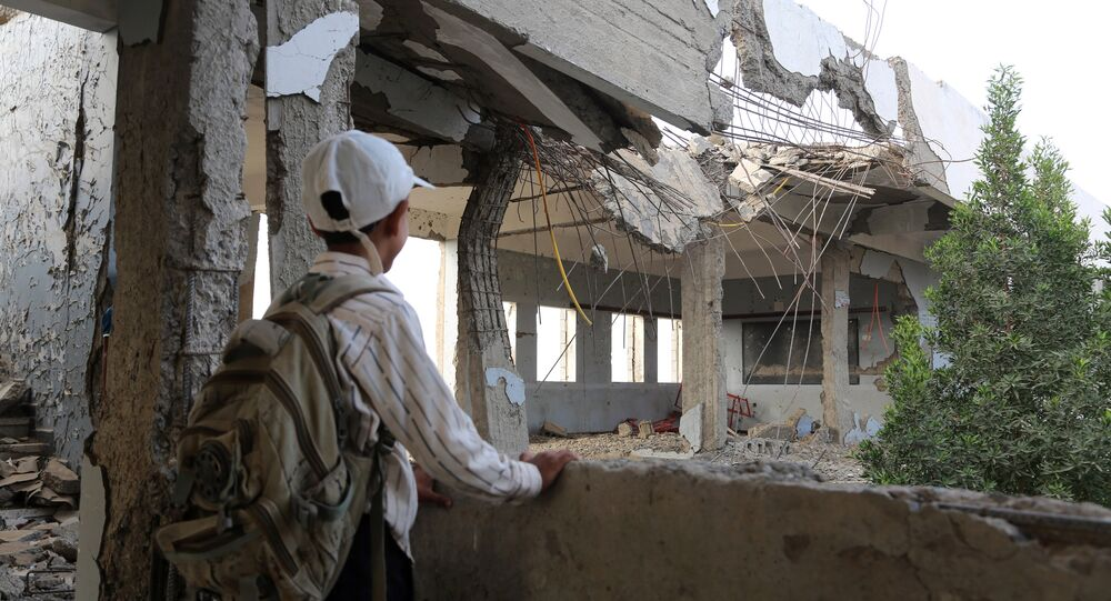 A Yemeni school boy looks at a destroyed school in the Yemeni port city of Hodeidah, on March 15, 2016, which was damaged in the country's ongoing conflict between the Saudi-led Arab coalition fighting Shiite Huthi rebels