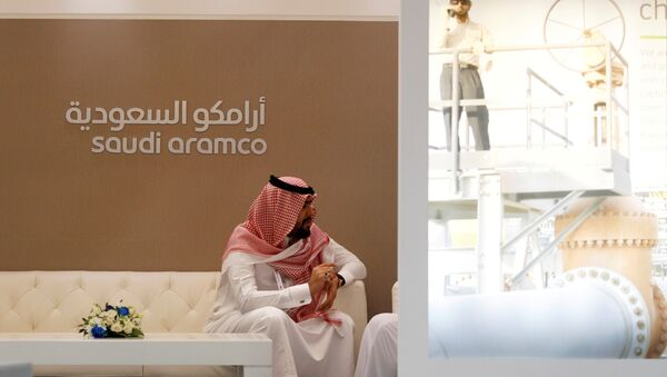 A Saudi Aramco employee sits in the area of its stand at the Middle East Petrotech 2016, an exhibition and conference for the refining and petrochemical industries, in Manama, Bahrain, September 27, 2016.  - Sputnik International