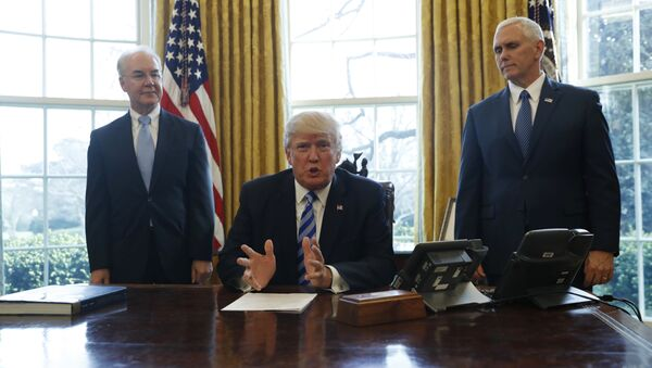 President Donald Trump, flanked by Health and Human Services Secretary Tom Price, left, and Vice President Mike Pence, meets with members of the media regarding the health care overhaul bill, Friday, March 24, 2017, in the Oval Office of the White House in Washington. - Sputnik International