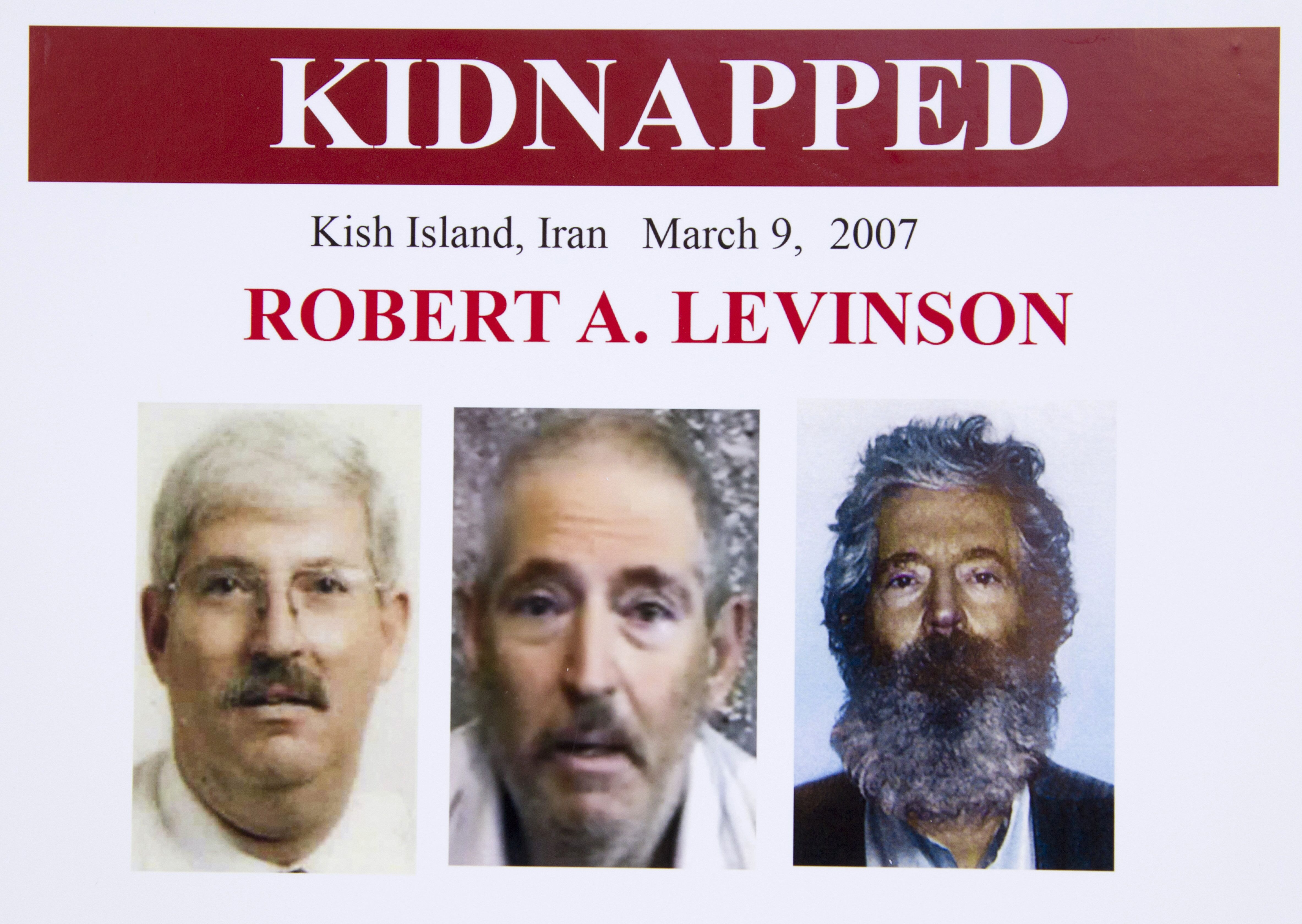An FBI poster showing a composite image of former FBI agent Robert Levinson (R) of how he would look like now after five years in captivity, and an image (C) taken from the video released by his kidnappers, and a picture before he was kidnapped (L).