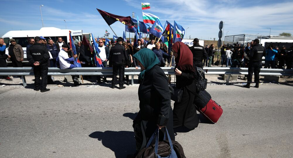 Women carry their luggage as they cross the border crossing between Turkey and Bulgaria on foot during a protest at Kapitan Andreevo border checkpoint, Bulgaria March 24, 2017