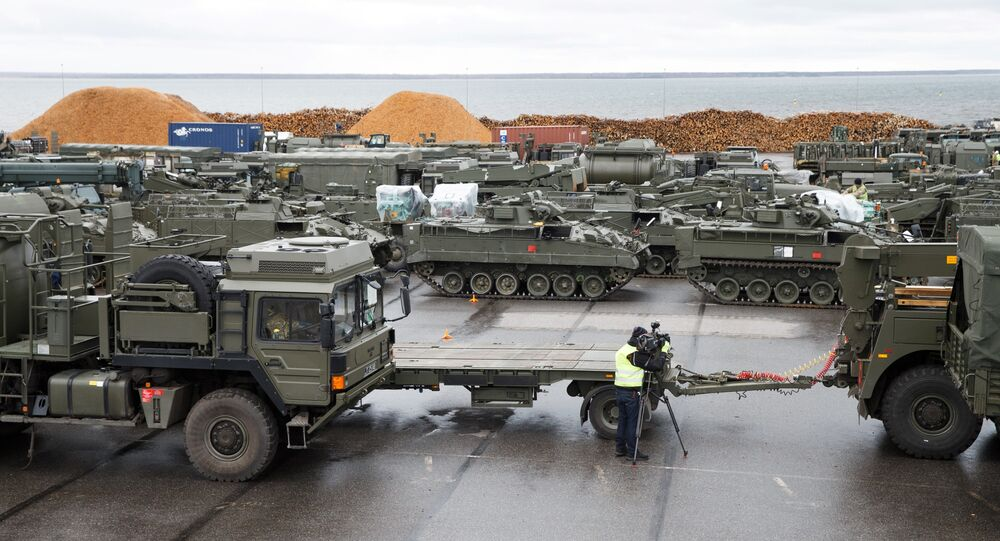 British tanks and military vehicles are unloaded at the port Estonian of Paldiski on March 22, 2017