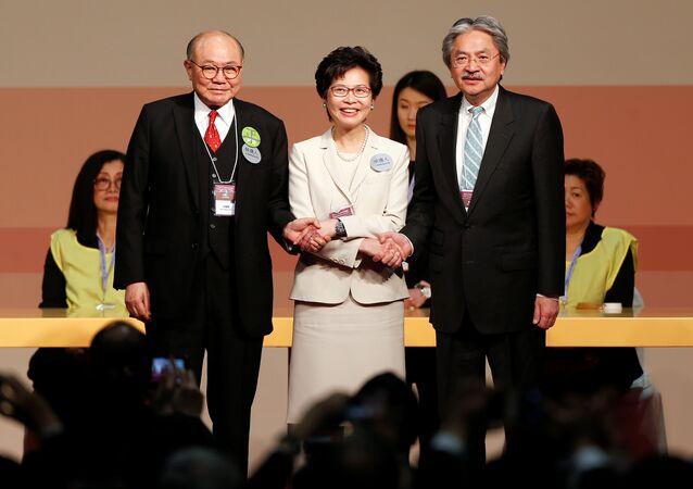 Candidates Woo Kwok-hing and John Tsang congratulate Carrie Lam (C) during the election for Hong Kong's next Chief Executive in Hong Kong, China March 26, 2017