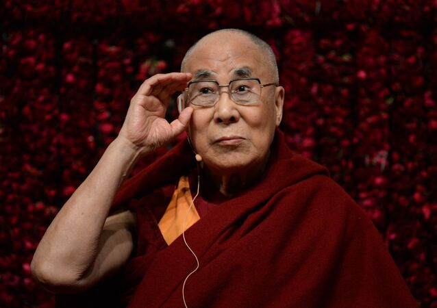 "Tibetan spiritual leader, the Dalai Lama, gestures before delivering a public lecture on ""Reviving Indian Wisdom in Contemporary India"" at a function in New Delhi on February 5, 2017"