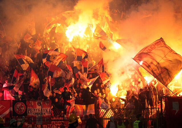 Russian and Serbian fans at the football match between FC Spartak Moscow and FC Crvena Zvezda in Belgrade