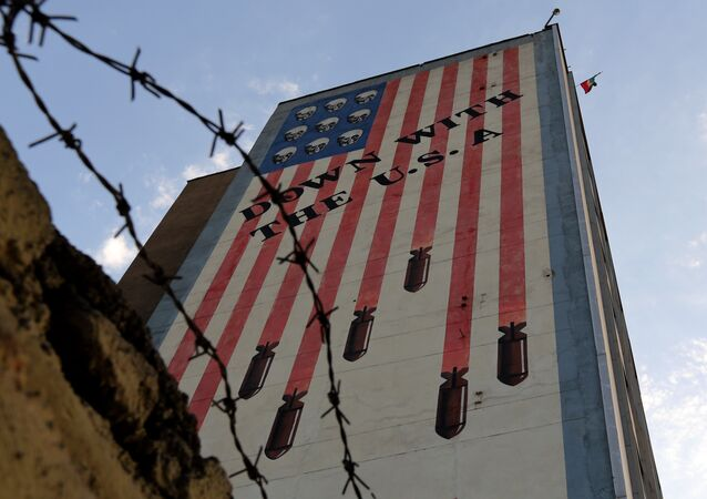 Graffiti with anti-US slogan is seen decorating the wall of a building in Tehran on July 14, 2015