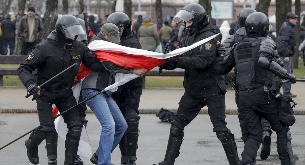 Belarus police detain a protester with an opposition flag during an opposition rally in Minsk, Belarus, Saturday, March 25, 2017