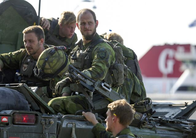 A 160-man combat team from Skaraborg Armoured Regiment deploy in Visby harbour in Sweden on September 14, 2016