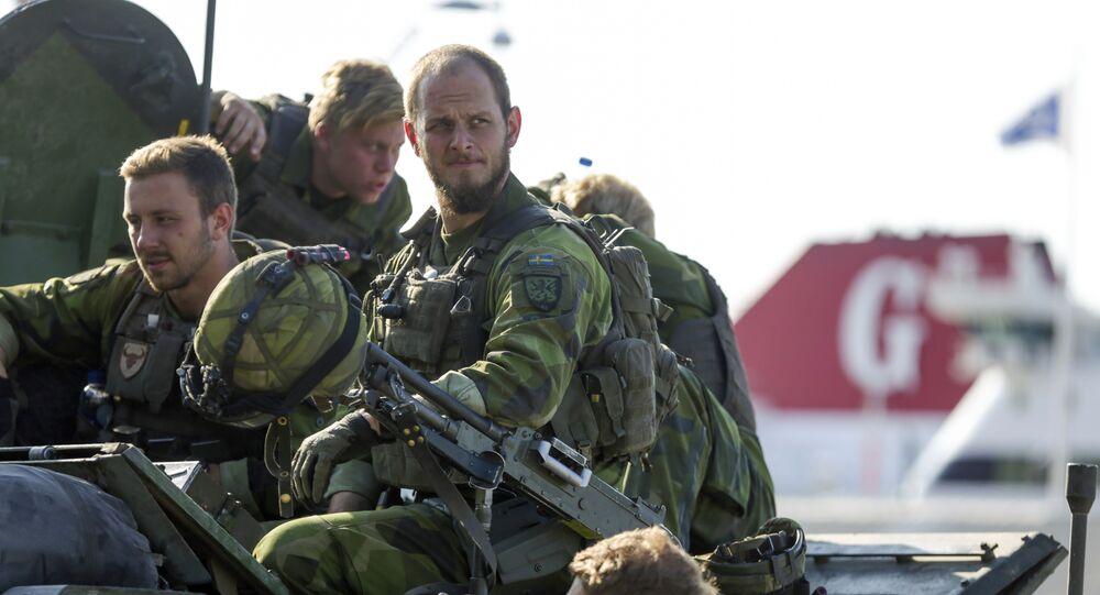 A 160-man combat team from Skaraborg Armoured Regiment deploy in Visby harbour in Sweden on September 14, 2016
