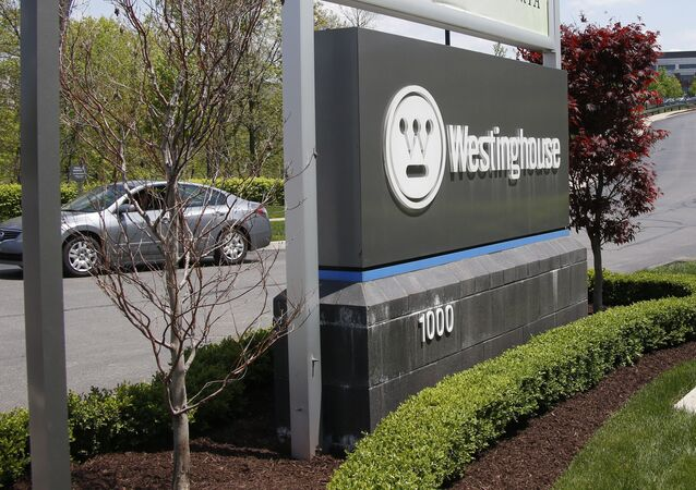 A vehicle exits the driveway from the Westinghouse International Headquarters.