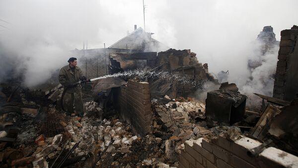 A firefighter douses a fire in Avdiivka after heavy shelling  (File) - Sputnik International