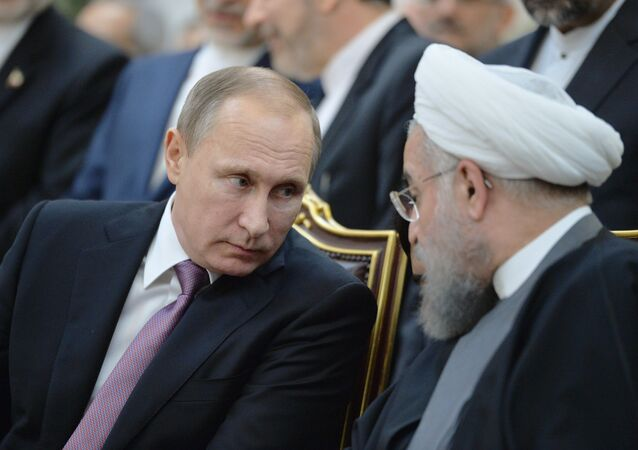 Russian President Vladimir Putin, left, and President of Iran Hassan Rouhani during the joint documents signing ceremony following the Russian-Iranian talks in Tehran, Iran, November 23, 2015