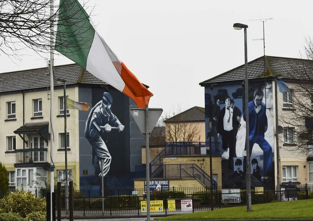 The Irish flag flies at half-mast after the death of Martin McGuinness, in the Bogside area of Londonderry, Northern Ireland, March 21, 2017.