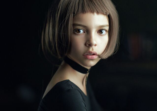 My art work is a portrait of a young girl called Nastya, who modeled for me in Moscow studio at summer 2016 after I got inspired by a famous French movie Leon with a cast of Natalie Portman and Jean Reno. This is the reason why my portrait is called: Mathilda, which was photographed as a cosplay of Portman's role in this movie.
