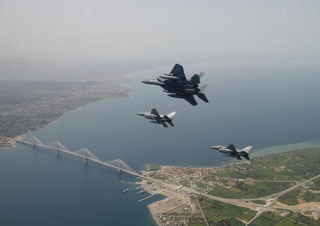 In this photo released by the Hellenic Air Force, two Greek F-16 fighter jets and a USAF F-15E Strike Eagles, based at Lakenheath airbase in England, fly past the 2,880-meter Rio-Antirrio Bridge in southern Greece, on Wednesday, April 13, 2016. The U.S. jets took part in Exercise Iniohos 2016, in southern Greece, together with military aircraft from Greece and Israel.