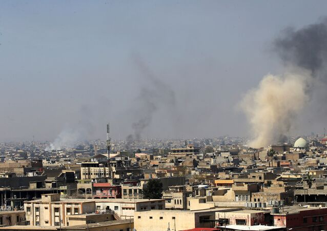 Smoke rises from the old city during a battle against Islamic State militants, in Mosul, Iraq