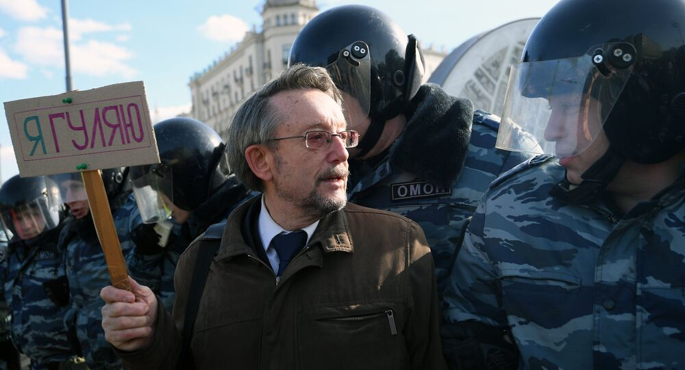 Participants in the unauthorized anti-corruption rally on Pushkinskaya Square in Moscow.