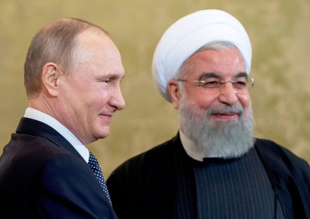 March 28, 2017. Russian President Vladimir Putin and President of the Islamic Republic of Iran Hassan Rouhani, left, during a meeting.