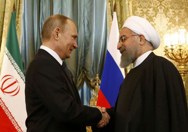 Russian President Vladimir Putin shakes hands with Iranian President Hassan Rouhani during their meeting at the Kremlin in Moscow, Russia March 28, 2017.