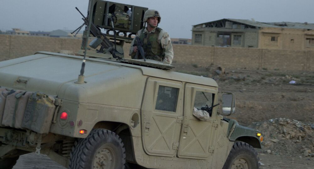 US soldier sits on top of a Humvee