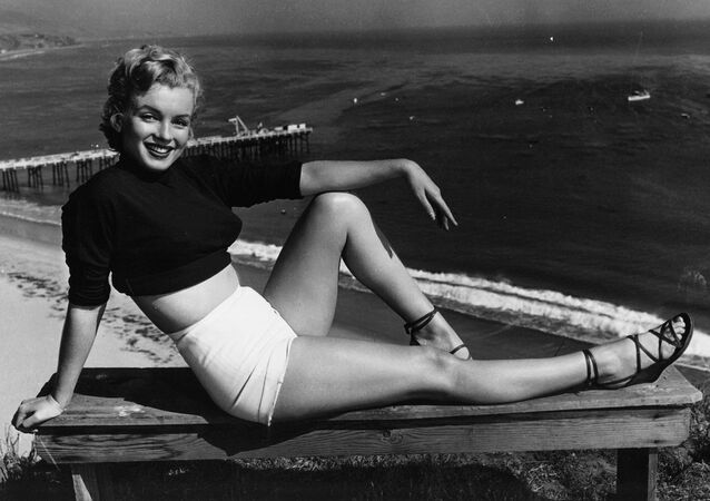 Marilyn Monroe has held a variety of jobs, from making five cents a week in an Orphan home to a stock contract at a studio. She clicked as the sexy girl in Asphalt Jungle, and the roles got better. She has been named to Miss Cheesecake of 1951 by stars and stripes, a service paper. (04/17/1951)