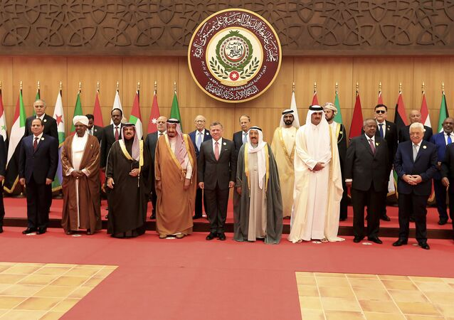 Twenty one kings, presidents and top officials from the Arab League summit pose for a group photo, at a gathering near the Dead Sea in Jordan