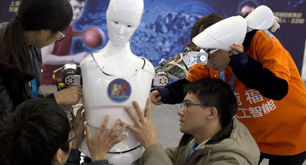 Chinese students work on the Ares, a humanoid bipedal robot designed by them with fundings from a Shanghai investment company, displayed during the World Robot Conference in Beijing. (File)