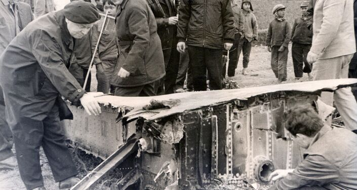 Soviet experts inspect the fragments of a B-52 bomber shot down over Hanoi in December 1972