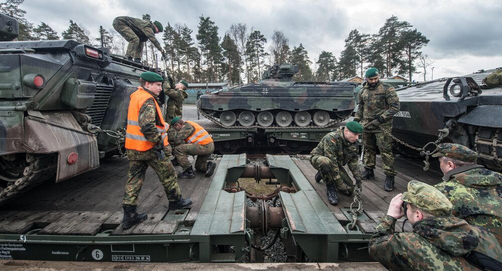 German soldiers load armored vehicles of the type Marder on a train at the troop exercise area in Grafenwoehr, southern Germany, on February 21, 2017.