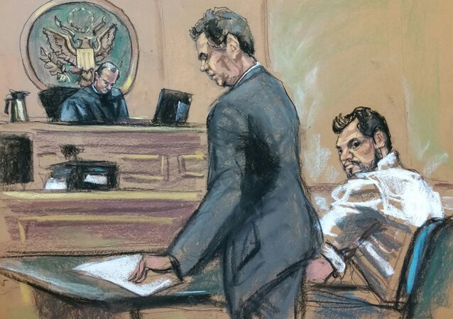 Mehmet Hakan Atilla (R), a deputy general manager of Halkbank, is shown in this court room sketch with his attorney Gerald J. DiChiara (C) as he appears before Judge James C. Francis IV in Manhattan federal court in New York, New York, U.S
