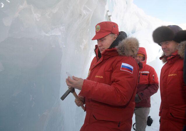 Russian President Vladimir Putin and Prime Minister Dmitry Medvedev visit the Polar Pilots Ice Cave on Alexandra Land Island in the Franz Josef Land Archipelago