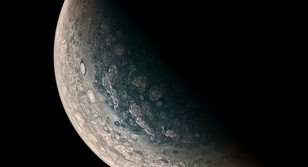 This Jupiter photo is courtesy of Juno, and clearly shows monstrous swirling storms on the planet's surface.