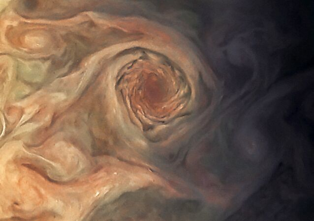 This Juno photo of Jupiter isn't the Red Spot, but rather the white pearl storms on Jupiter, just southwest of the White Oval.