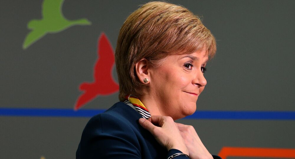 Scotland's First Minister Nicola Sturgeon smiles as she visits Genpact, an Indian multinational company, where she announced new jobs for Scotland Wednesday March 29, 2017.