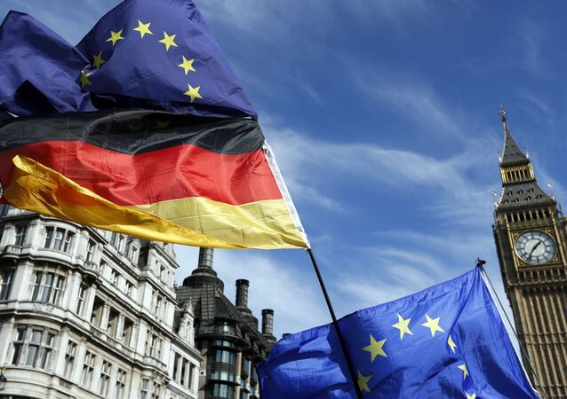 Anti Brexit campaigners carry a Germany flag and European flags outside Britain's parliament in London, Saturday March 25, 2017.