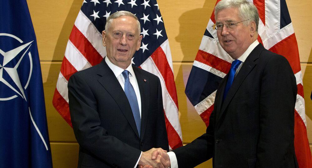 US Secretary of Defense Jim Mattis, left, shakes hands with British Secretary of State for Defense Michael Fallon