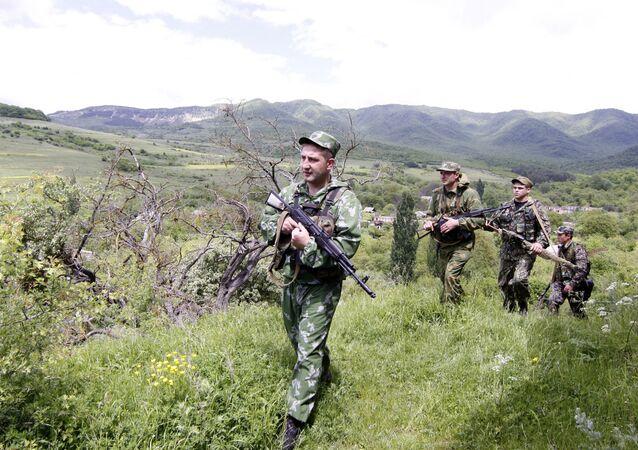 Patrolling the Georgian -- South Ossetian border in Disev village.