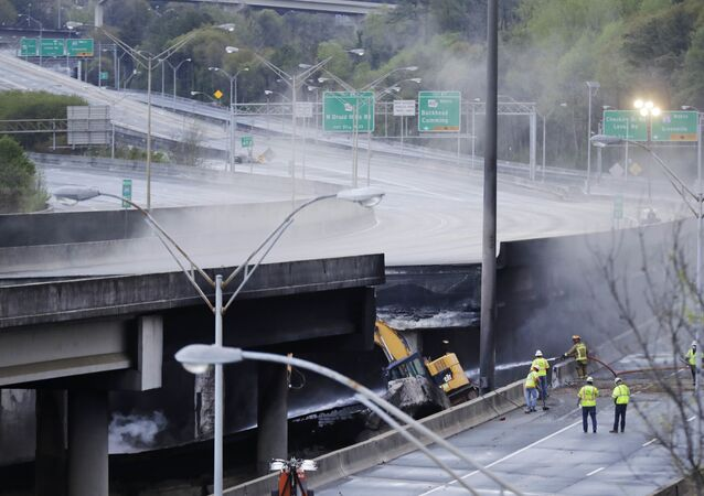 Crews work on a section of an overpass that collapsed from a large fire on Interstate 85 in Atlanta, Friday, March 31, 2017. Many commuters in some of Atlanta's densely populated northern suburbs will have to find alternate routes or ride public transit for the foreseeable future after a massive fire caused a bridge on Interstate 85 to collapse Thursday, completely shutting down the heavily traveled highway.