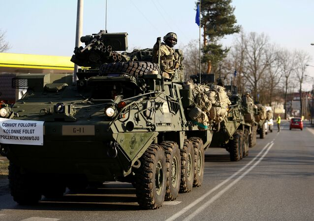 A convoy of U.S. troops, a part of NATO's reinforcement of its eastern flank, who are on their way from Germany to Orzysz in northeast Poland, drive through Sulejowek towards a military base in Wesola, near Warsaw, Poland, March 28, 2017