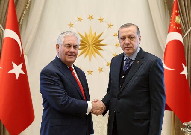 US Secretary of State Rex Tillerson, left, poses with Turkey's President Recep Tayyip Erdogan prior to their meeting in Ankara, Turkey, Thursday, March 30, 2017