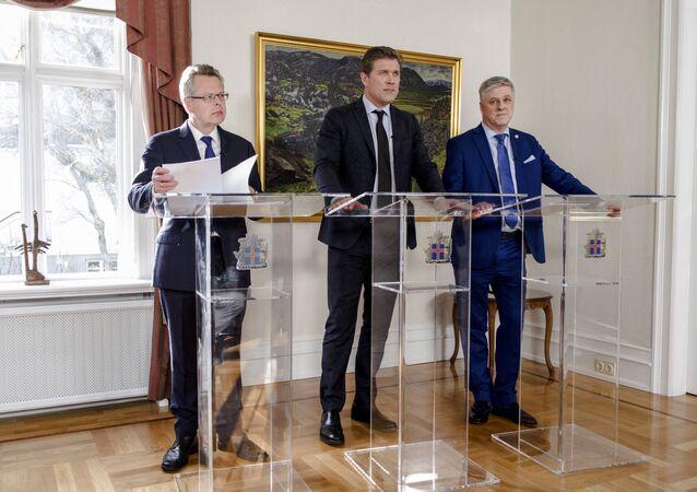 Iceland's Central Bank governor Mar Gudmundsson (L to R), Prime Minister Bjarni Benediktsson, Finance minister Benedikt Johannesson attend a news conference in Reykjavik, Iceland, March 12, 2017