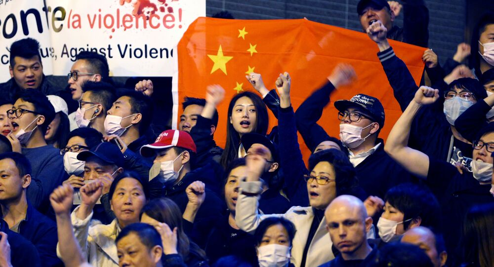 Members of the Chinese community shout slogans during a protest at Place de la Bastille in Paris, France, March 30, 2017