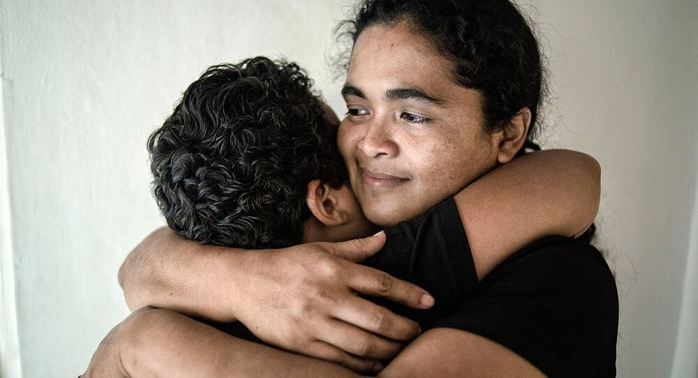 Maria Teresa Rivera hugs her son after being released from prison in 2016.