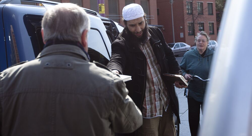 A member of a Muslim group distributes copies of the Quran at Potsdamer Platz in Berlin (File)