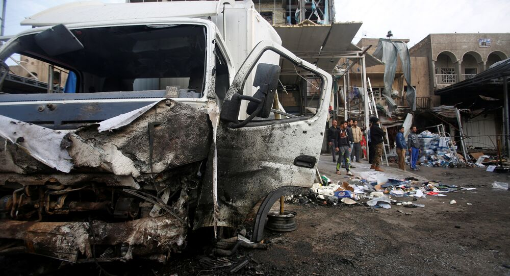 A damaged vehicle is seen at the site of car bomb attack in the Amil neighborhood in Baghdad, Iraq March 21, 2017