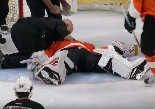 Michal Neuvirth collapses on the ice, leaves game on stretcher