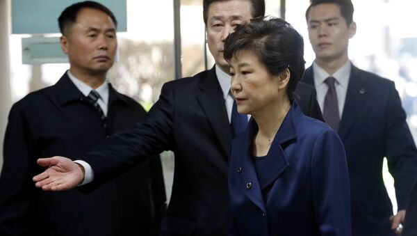 Ousted South Korean President Park Geun-hye arrives for questioning on her arrest warrant at the Seoul Central District Court in Seoul, South Korea, Thursday, March 30, 2017 - Sputnik International
